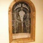Etched panel for wine cellar