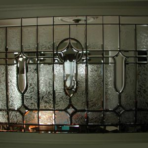 Beveled glass room divider designed to allow for semiprivate separation